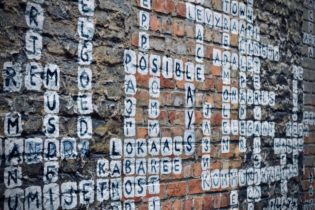 scrabble art on a wall (Unslpash)