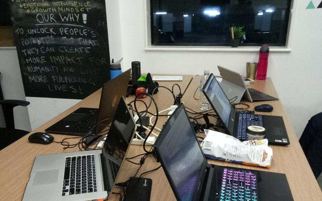 Four laptops on a desk